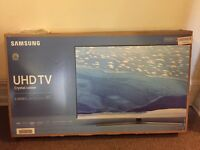 "Samsung 49"" 4K UHD tv"
