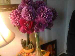 Beautiful vase filled with new purple flowers. 10.00