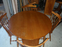 solid maple dining table and 3 solid wood chairs in good cond ,