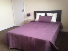 Two Large double rooms with en-suite shower and toilet in furnished house shared by professionals.