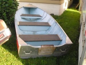 14ft. aluminum springbok next to new shape boat only