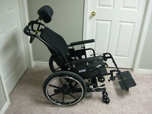 Tilt wheelchair w/Roho high profile cushion