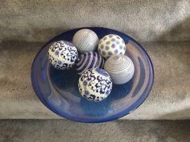 Glass bowl and decorative ceramic balls