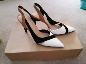 Brand NEW leather high heels shoes.