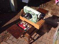 Pinnoc sewing machine and table comes with all in picture