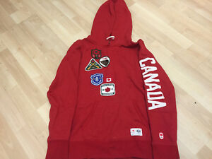 Red Olympic Sweater, worn but warm