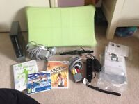 Nintendo wii console in black with wii fit board and games
