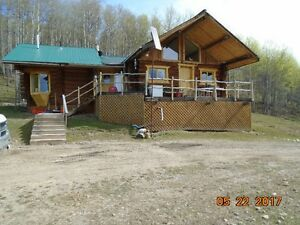 Log home on 143  acres, facing toward the mountains for rent