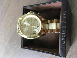 $100 a Michael Kors women's gold watch!