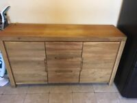 Very solid light Oak Sideboard with cupboards and shelves