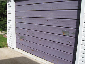Wanted to Buy ONEPIECE Steel  GARAGE DOOR THAT TILTS OUT