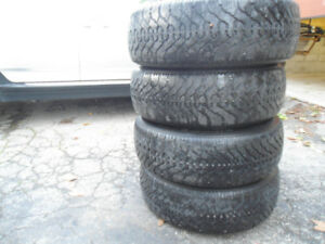 205/55/16 winter tires + bmw rims and hub caps -must sell