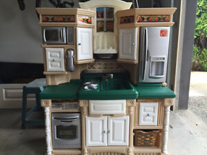 Kids kitchen set with box of plastic food