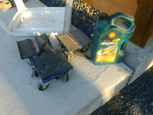 Two stroke snowmobile synthetic oil and dollies