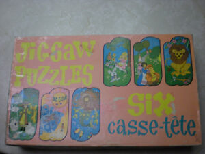 Box set of 6 Jigsaw Puzzles in tubes