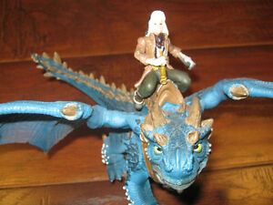 Schleich Dragon toy with man, and Ravensburger dragon puzzel