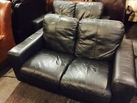 2 black leather 2 seaters sofas