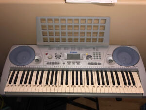 Keyboard (Yamaha) for sale, with stand and stool.