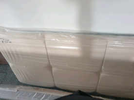 A new still packed cream fabric 4ft three quarter head board.