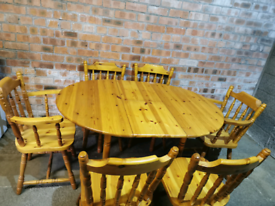 Extendable circular pine table & 6 chairs