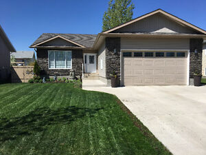 Nearly New Open Concept Raised Bungalow