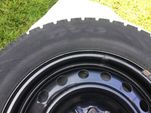 4 ALMOST NEW TOYO WINTER TIRES WITH STEEL RIMS.