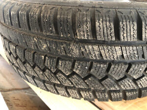 4 winter tires with rims.