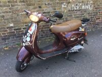 Cheap Vespa et4 125 with mot and serviced 595