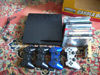 PS3 WITH 4 CONTROLERS AND 23 GAMES