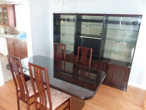 Dining set with matching display cabinets.