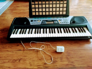 Yamaha black and white electronic keyboard