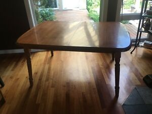 Dining room table with two leaf extensions