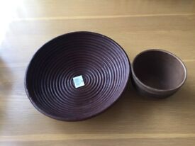 Brown wooden plate with plant pot