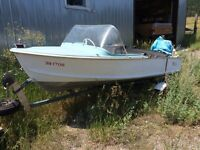 14 foot fibreglass boat with trailer.