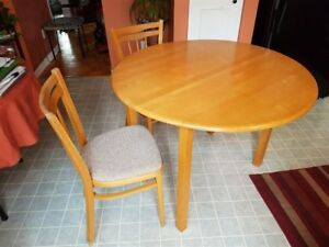 "42"" dia. Table and 4 Chairs"
