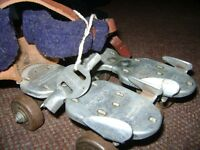 ANTIQUE YOUTH ROLLER SKATES WITH LEATHER STRAPS