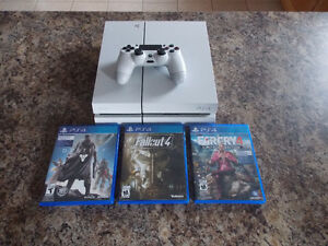 PS4 with 2 Controllers, 4 Games.