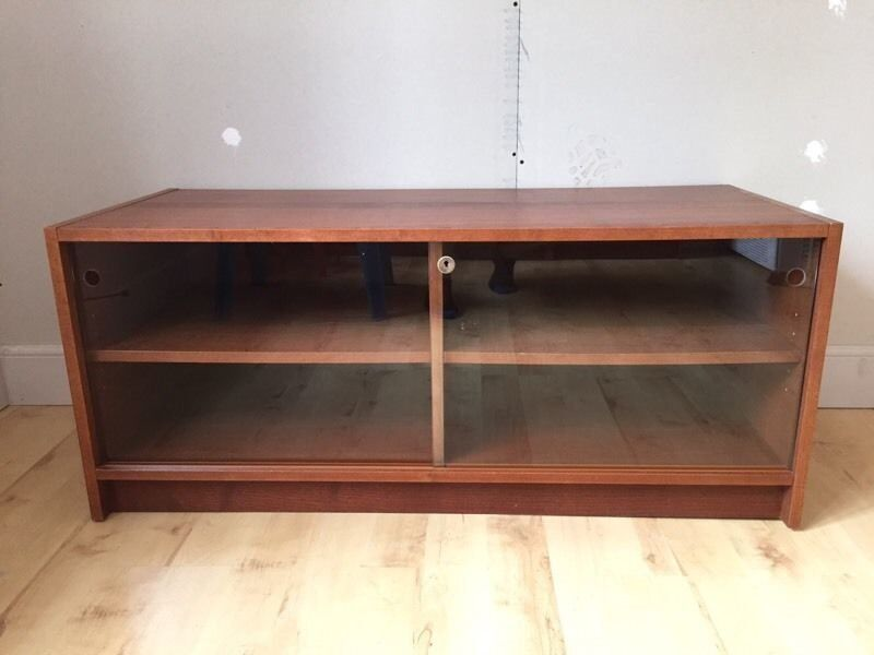 Benno TV unitin Southside, GlasgowGumtree - Benno TV unit with 4 shelves and lockable glass sliding doors size 1180mm wide x 500mm deep x 500mm high dark brown wood (walnut) colour. All in great condition