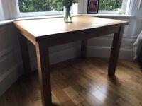 Solid oak veneer extendable dining table