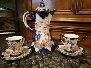 Antique Asian Cocoa pot with two matching cups and saucers