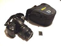 Nikon D3000 DSLR with 4gb SD ,18-55mm VR lens and bag