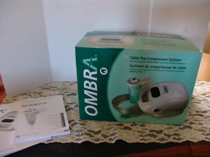 Ombra Table Top Compressor System in box