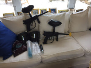 Complete set of 2 paintball guns, used twice.  All you need!