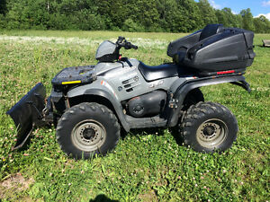 2002 POLARIS 500 MAGNUM WITH PLOW......FINANCING AVAILABLE