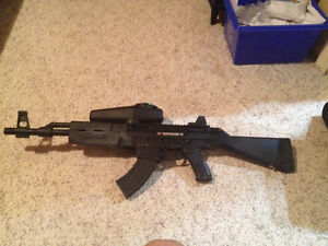 Tippmann X7 (AK47), tactical vest, and other paintball gear