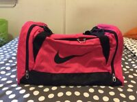 Hot pink Nike duffel gym bag