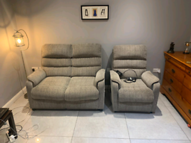 2&1 seater sofa in grey fabric, armchair is an electric recliner £150