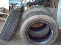 three 275/65r18 tires