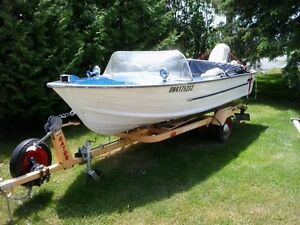 16 foot Aluminum Starcraft with Gator trailer 40hp Johnson