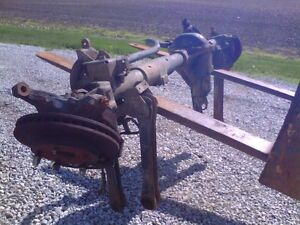 94 - 2001 ram front axle housing complete with half shafts